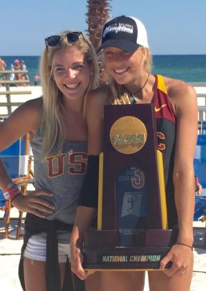 Zoe Nightingale '11 (holding the trophy) with sister Noa Nightingale '14 after the NCAA Champioships.
