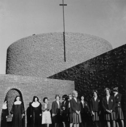 Sisters with students in front of St. Francis High School in 1965