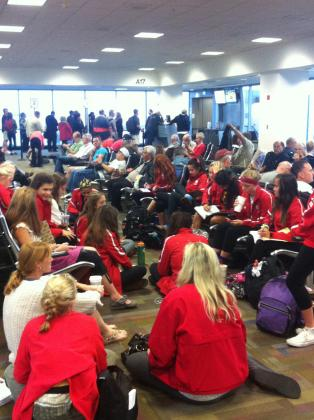 The St. Francis cross country team sits in the Sacramento Airport Friday before flight was canceled.