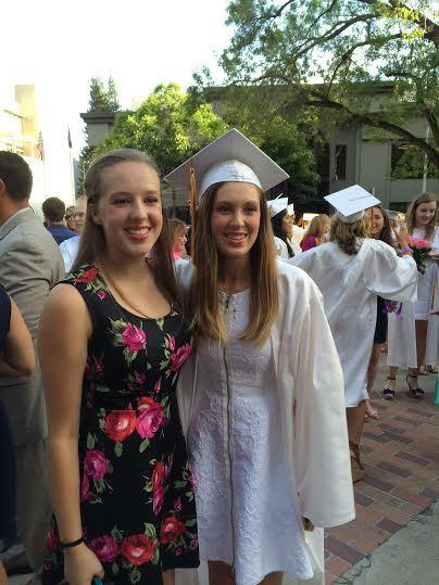 Alumna Jennifer (track) and volleyball junior Kelsey Grover at Jennifer's graduation.