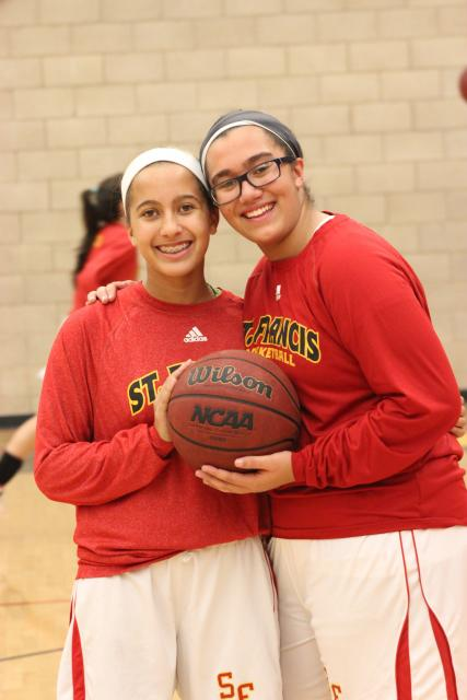 Anna and Rachel Huber played for the freshmen basketball team this season. #NationalSiblingDay #TroubieTakeover
