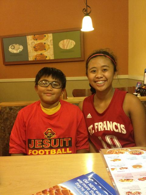 Maryael Ramos is often cheered on by her brother, Mario, at her basketball games. He plays for the Jesuit Junior Marauders.