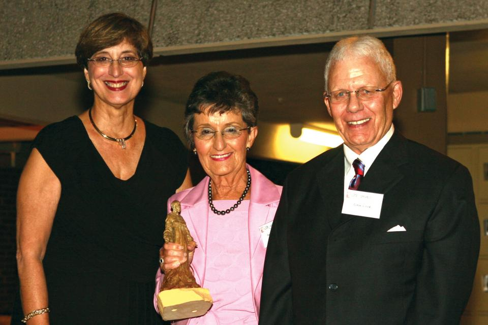 Sandra & John Cook receiving the Pax et Bonum Award from President Marion Bishop in 2009.