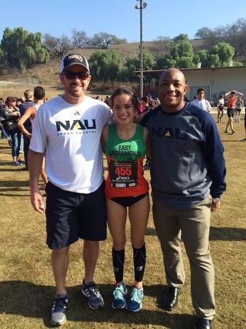 Myers with Northern Arizona coaches Eric Heins and Kenny McDaniel at the Footlocker meet.